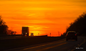Sunset on US interstate highway I-90. Copyright 2015. All rights reserved.