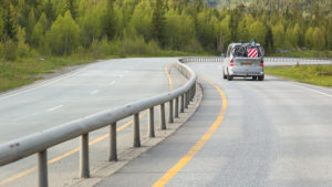 Central guardrail / crash barrier on a rural road -- a Swedish road safety innovation.