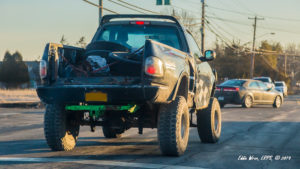 A jacked-up pick-up truck.
