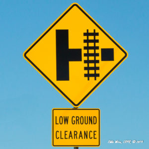 Traffic sign for a railroad crossing with low ground clearance.